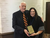 OSU College of Education counseling program coordinator Gene Eakin is presented the 2017 Leona Tyler award.