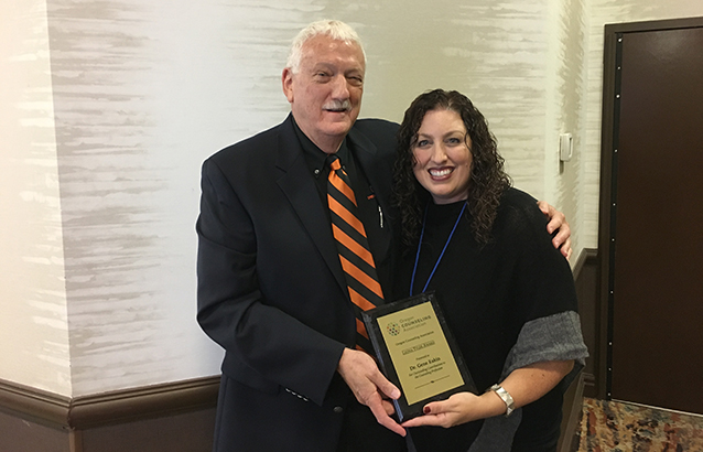 OSU College of Education counseling program coordinator Gene Eakin is presented the 2017 Leona Tyler award.