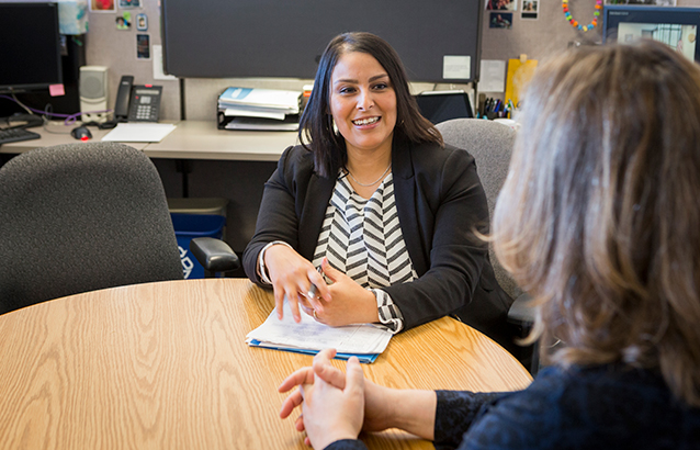 Jessica Nguyen-Ventura, who earned a Master of Public Policy at Oregon State University, is seated at a round table across from someone in an office setting.