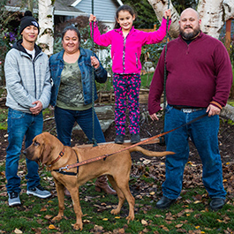 Todd with his family, including his wife and two kids and their excellent dog.