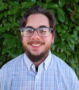 Headshot of Caiden Marcus, an undergraduate transfer student advisor and instructor in Oregon State University's College of Business