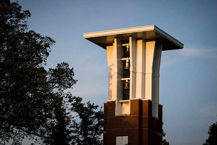 Clock and bell tower on the campus of Oregon State. Online teaching
