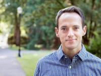 An outdoor photo of Sean Newsom, a Ph.D. professor of kinesiology at Oregon State University. He teaches kinesiology online and on campus.