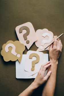 When you've been laid off, fired, or furloughed, you don't know when you'll be back to being full time again. This image is a bunch of question marks, representing the 7 questions we raised about that.