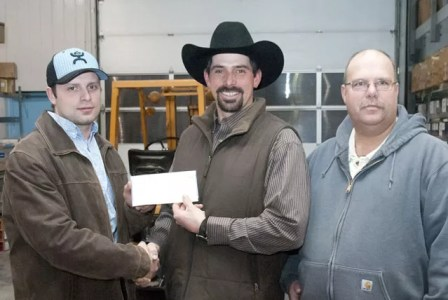 Coronation Pro Rodeo president Curtis Perry (centre) accepted a $1500 cheque from PennWest Exploration on Thursday, January 17. Presenting the cheque was (L-R) Aaron Davies and Eugene Dem.