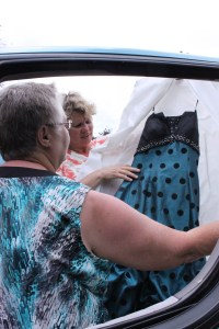 Rowena Swahn and Teresa Gerber of Coronation looked at a polka-dotted grad dress June 30 before they loaded it into a truck headed for Calgary. Swahn and Gerber collected grad dress donations for the graduating class in High River, Alberta.