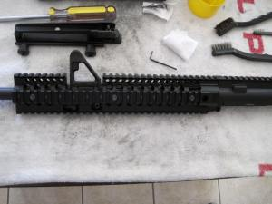 Install the DD lower rail on barrel nut and secure it to the upper rail with the (6) rail screws. Tighten down the (4) Allen head screws on barrel nut
