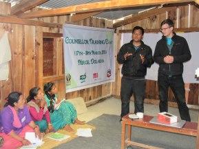 Mr. Slusanrenka looks on while giving a speech as ECCA Program Officer Mr. Dipesh Gurung translates it for him