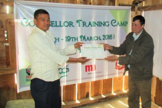 Mr. Sedai right hands over certificate to a participant