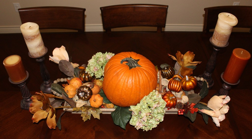 Autumn table centerpiece with natural pumpkin