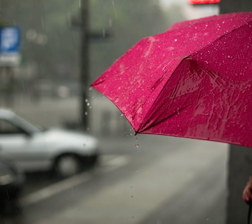 red umbrella under heavy rain