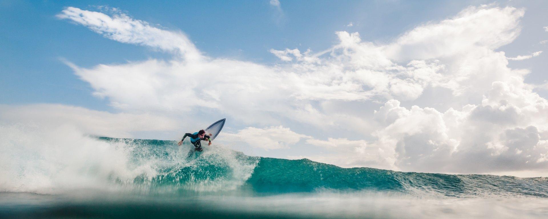 man surfing large wave in ocean