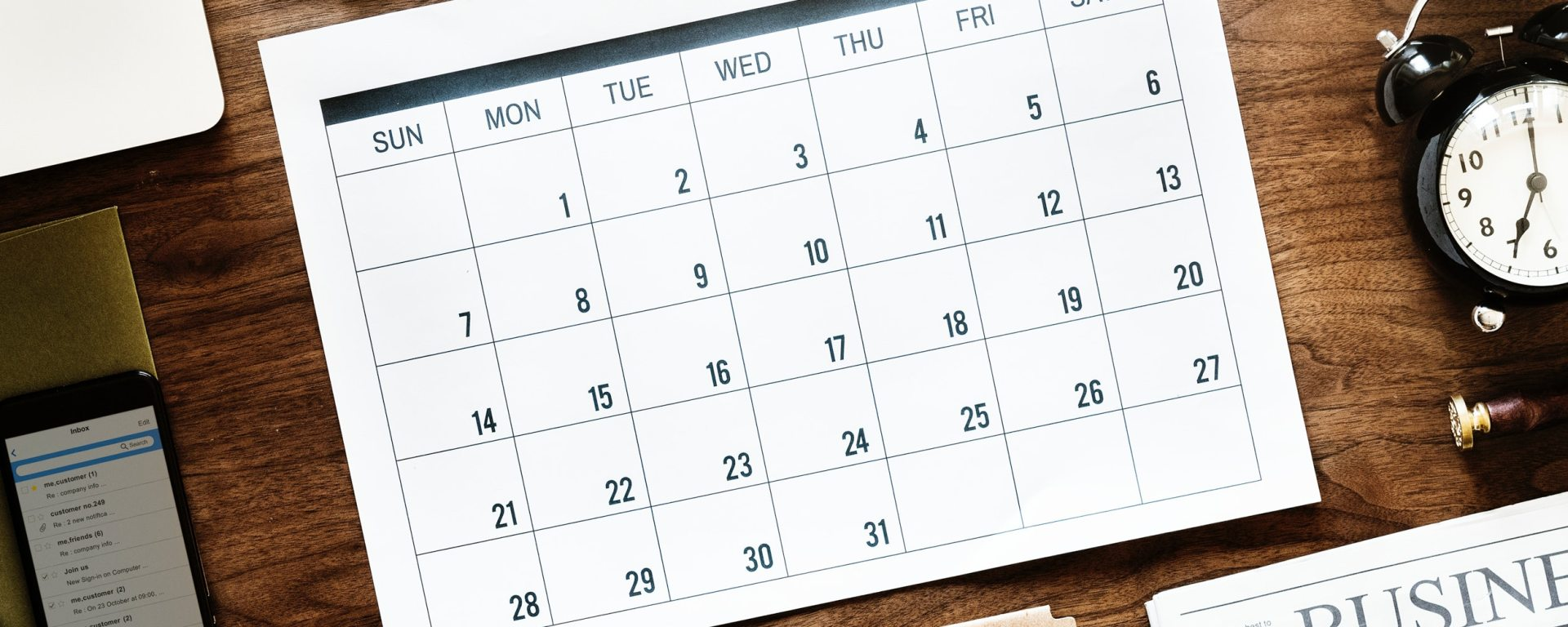blank generic calendar on wooden desk