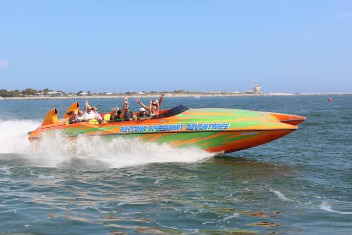 speedboat racing on the water in inlet