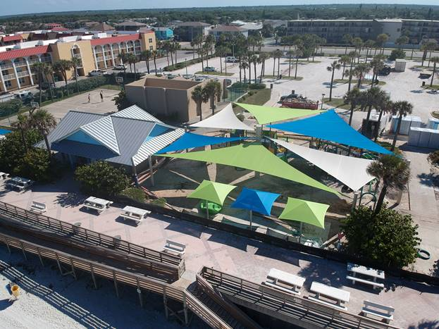 Newly installed shade sails cover the new 27th Avenue Beachfront Park playground in this photo taken May 21, 2019. (City of New Smyrna Beach/Phillip Veski)