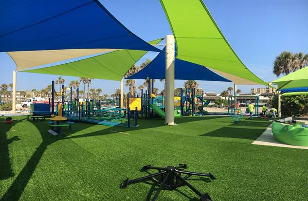 Soft green turf blankets the playground in this photo taken May 28, 2019 (City of New Smyrna Beach/Michelle Vallance)