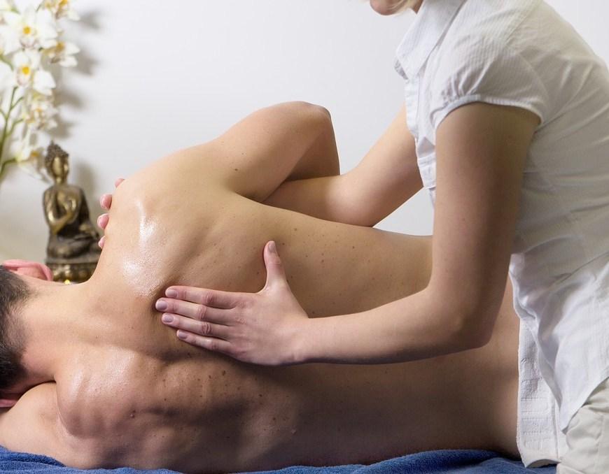 shoulder and back massage on man
