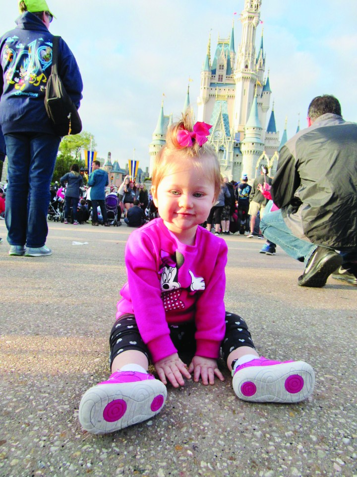 baby in front of castle at Disney world Orlando florida