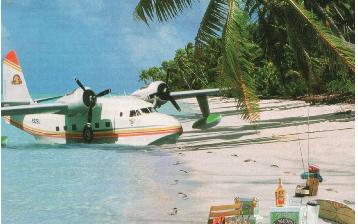 seaplane parked on tropical beach
