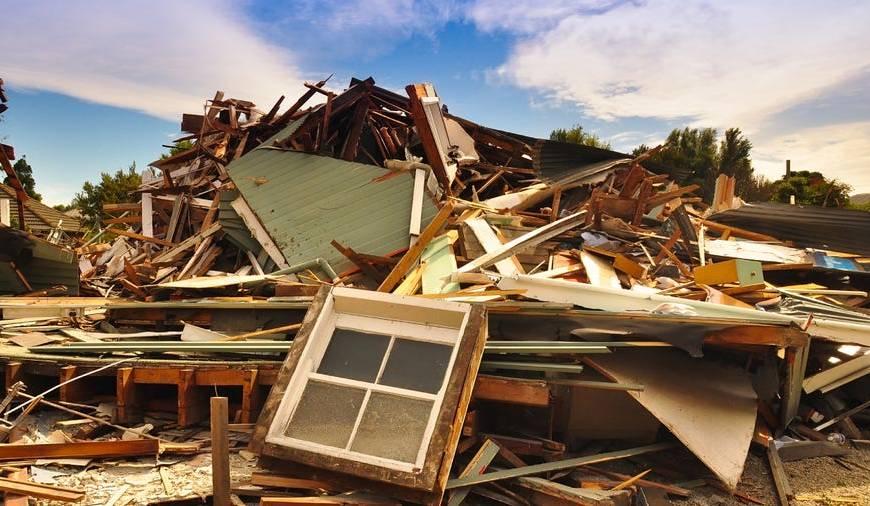 destroyed home pile of debris after natural disaster