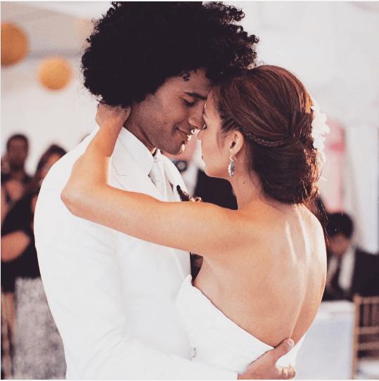 Anjelah Johnson and Manwell Reyes at their wedding