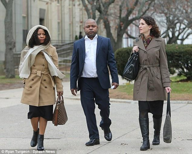 Jelani Maraj with lawyer walking to the court