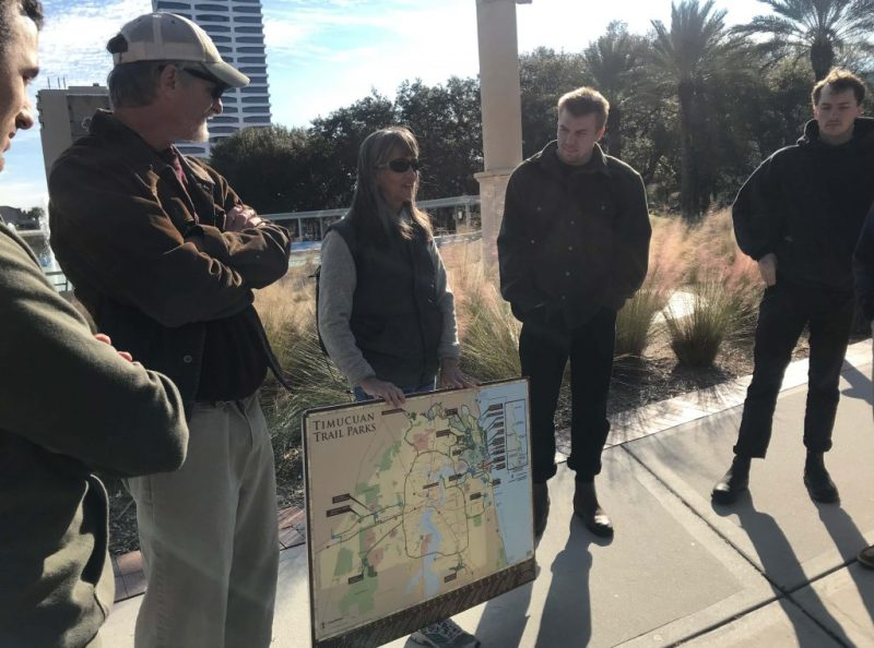 Woman holding map of parks in Jacksonville.