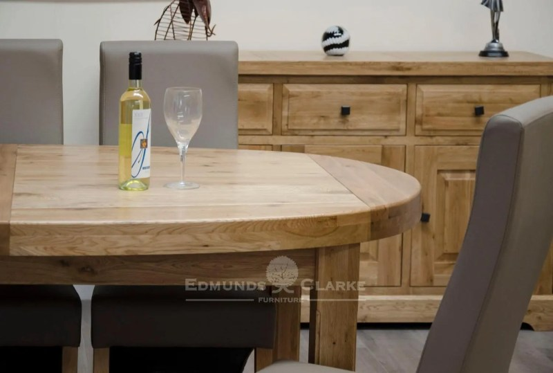 Huge super oval solid oak dining table with two stowable leaves
