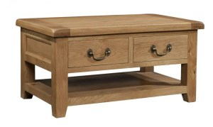 Somerset Oak 2 Drawer Coffee Table. 2 handy drawers with shelf at the bottom. Chunky contemporary waxed oak .chunky top, tapered legs and dark antique brass round rustic drop down handles. SOM068