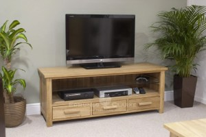 Bury Solid Oak Plasma TV Unit. Adjustable glass shelf for media items, 3 handy drawer under, chrome handles as standard. oak bar handle as optional extra