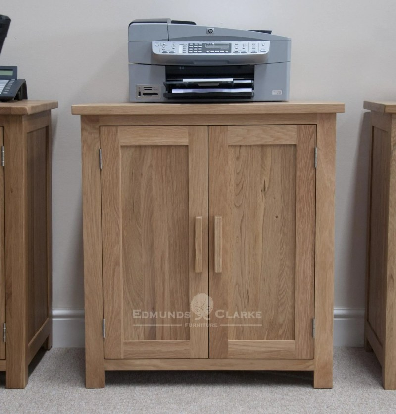 bury solid oak printer/occasional cupboard. adjustable shelf, chrome handles as standard, oak bar handle available as extra