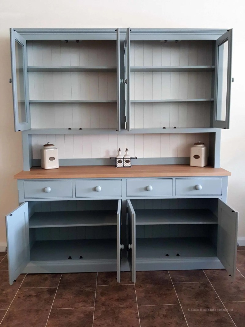 Edmunds 6'6 Painted Half Glazed Dresser. with contrasting white backboards. sideboard has square oak top with 4 drawers and 4 doors. painted knobs and all adjustable shelves. choice of handles and knobs. Image showing doors open.EDM030