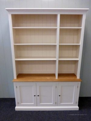 Edmunds Painted 3 door library bookcase. Adjustable shelves, 3 cupboards underneath with oak top on cupboards. Elegant cornice and plinths. Image showing doors open. EDM049