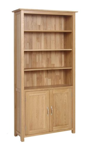 Norwich Oak Bookcase Cupboard. Contemporary shaker style straight lines and shaped edges on tops. shaped chrome bar handles.3 adjustable shelves and 1 fixed. 2 handy doors with 1 adjustable shelf. NNO55