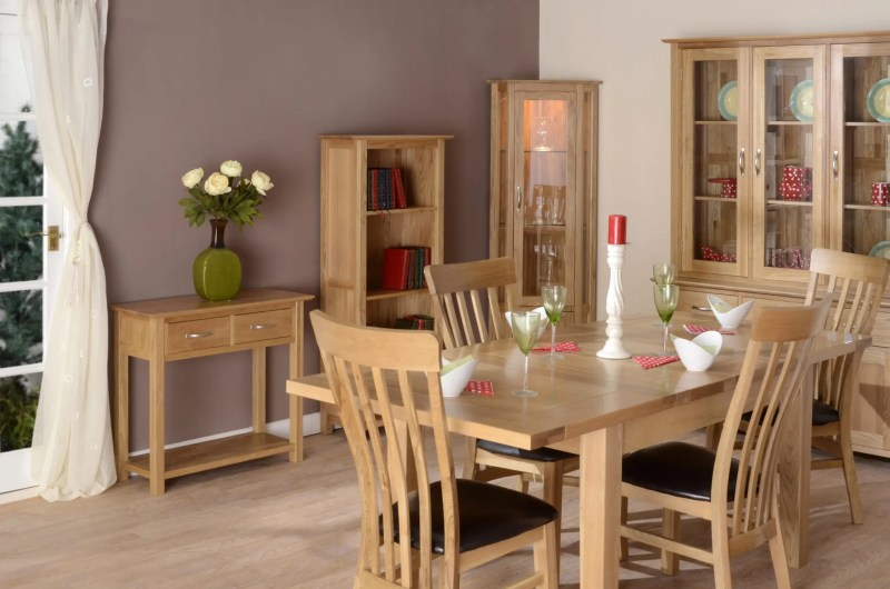 Image of room set Norwich oak dining furniture, table and 4 toulouse chairs, 2 drawer console table, bookcase, corner display unit, 4'6 dresser by edmunds & clarke furniture