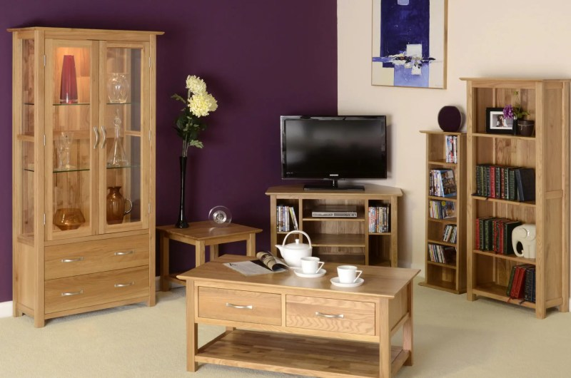 Image of room set Norwich oak occasional furniture, corner tv unit, 2 drawer coffee table, cd/dvd rack, bookcase and glazed unit by edmunds & clarke furniture