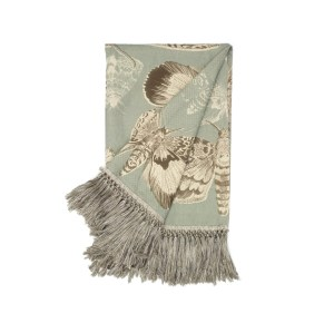 Voyage Maison Nocturnal Seathistle Throw moths on a duck egg blue background with gresy tassel edge