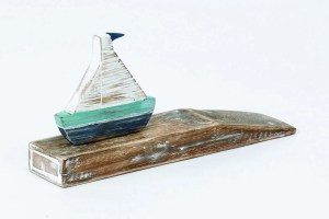 Archipelago Boat Doorstop Wood Carving D304. Blue and white sailing boat on a wedge of driftwood