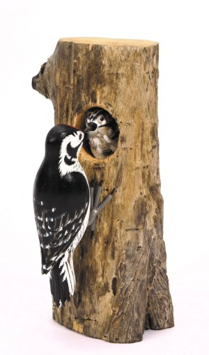 Lesser Spotted Woodpecker Wood Carving D366. perched on a wood block feeding its young baby through the tree trunk. Fair trade
