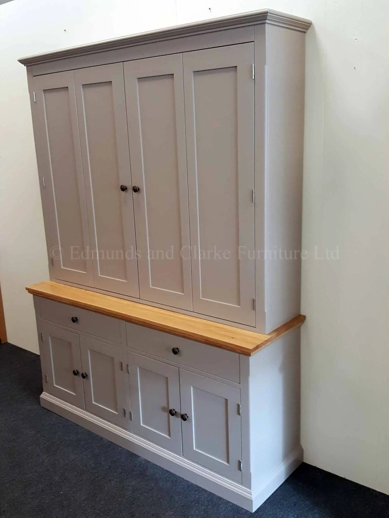 Edmunds painted television cupboard made in two parts top section has bifold doors