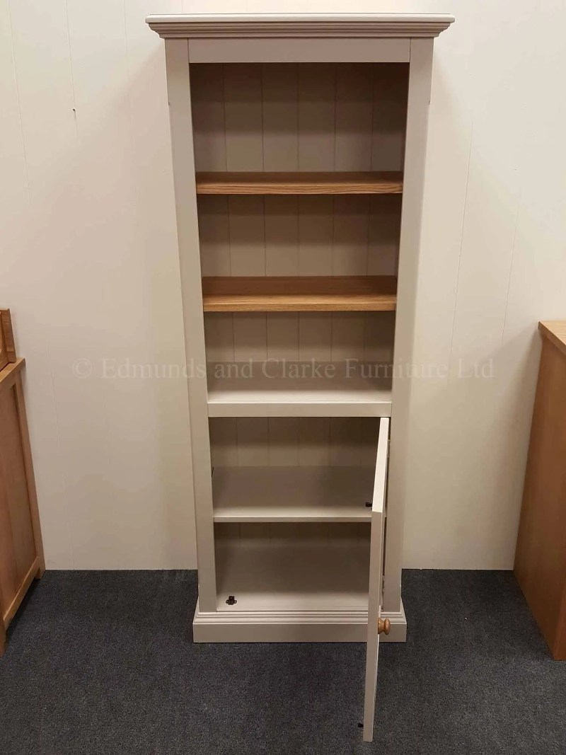 Edmunds painted narrow bookcase with cupboard below