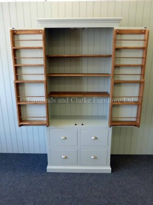 edmunds painted larder cupboard. hidden spice racks on inside of doors. image showing painted all over with pine shelves.4 large deep drawers under. 10 colours to choose from with various handle and knob options to choose from only at edmunds clarke bury st edmunds