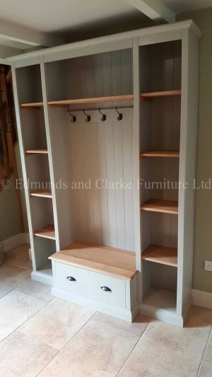 Bespoke Hallway Storage. with open coat rack and storage seat and shelving either side
