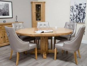 Melford Solid Oak Round Extending Dining Table. extends to a oval. image shows marjukka colour tungsten chairs