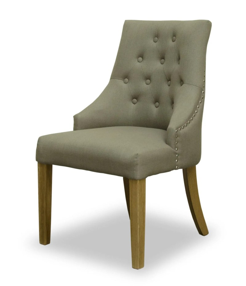 windsor comfort fabric dining chair. dark beige with button back and studded edges. Oak legs
