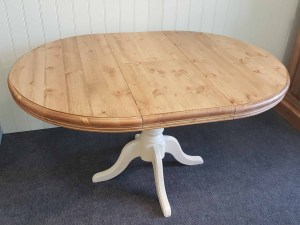 Edmunds painted pine table, central pededestal leg that have been painted. table extends into a butterfly leaf. sits 4-8 people easy