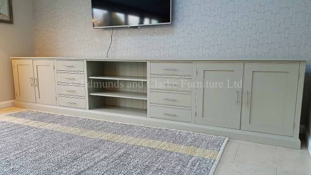 Long wide painted all over tv entertainment stand with eight drawers and four cupboard doors