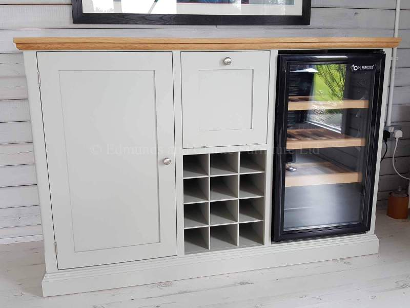 Edmunds painted drinks unit with wine rack that holds 12 bottles. a drop down flap for glasses. this particular cupboard has space for a wine cooler. 10 colours to choose from with solid oak top and choice of handles