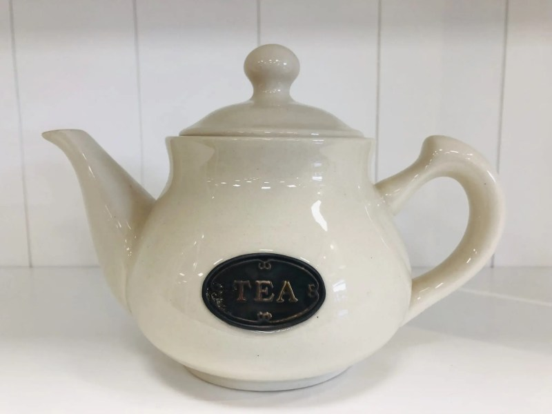 country kitchen ware - cream teapot with badge on front