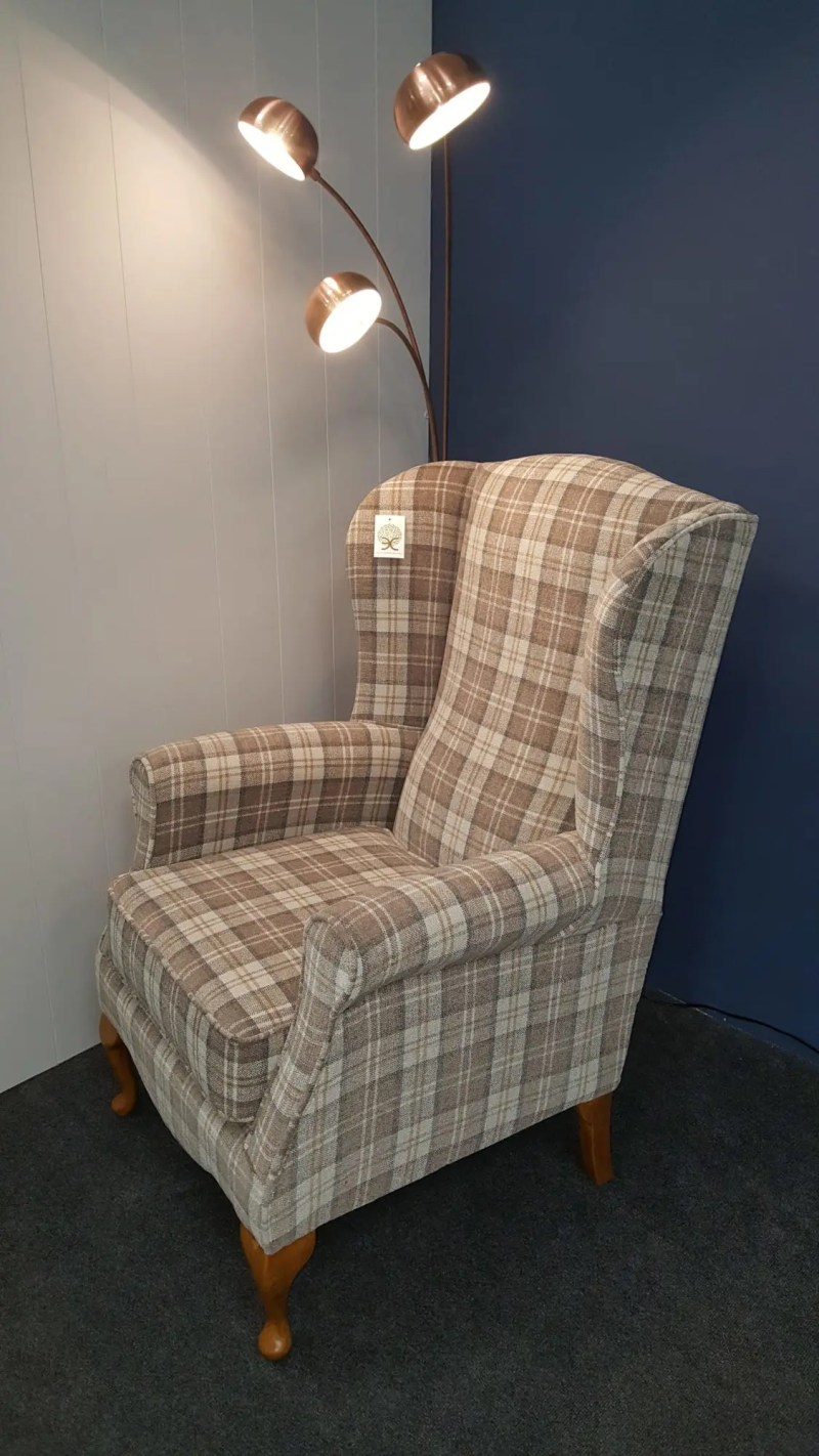 Fabric wing chair in a check fabric . Many fabrics to choose from